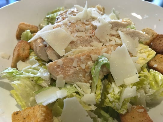 The chicken Caesar salad at Legal Grounds Cafe is $7.