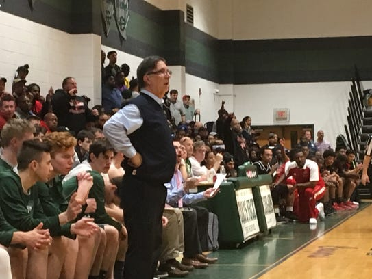 Colts Neck basketball coach Lou Piccola watches the
