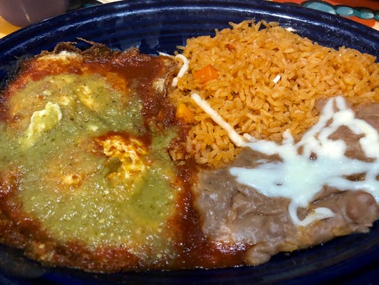 The huevos rancheros served with rice and refried beans