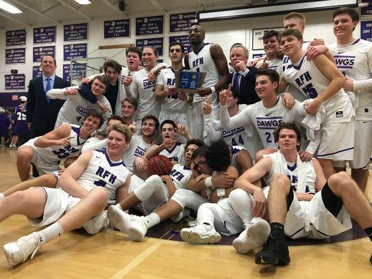 The Rumson-Fair Haven boys basketball team celebrates