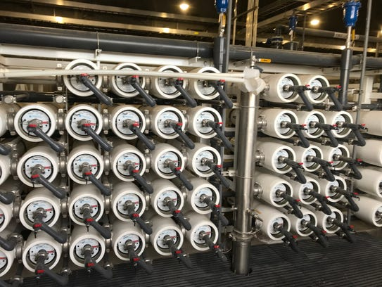 Water is pumped at high pressure through filters to