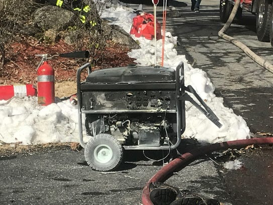 A generator against a garage door ignited a fire to
