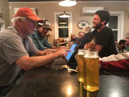 Bob Huntley takes an order during Black Narrows Brewing