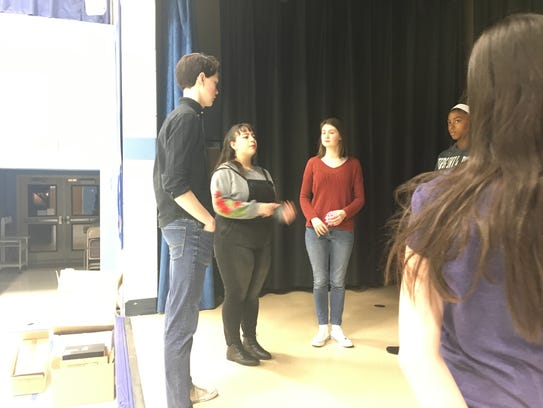 """Abigail Sanie (second from left) speaks with her cast and staff before a practice of """"Seussical, Jr."""" at Van Zant Elementary School in Marlton. The Cherokee High School junior is producing and directing the show, which is earning her a Girl Scout Gold Award."""