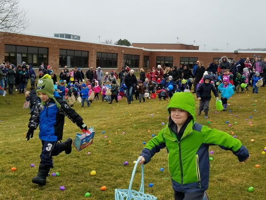 And they're off! Children race to find eggs at the