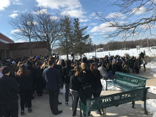 Montville High School students gather outside the front