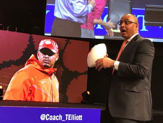 Clemson assistant coach Tony Elliott prepares to toss