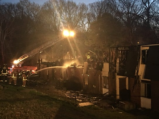 Firefighters on the scene of an apartment fire early