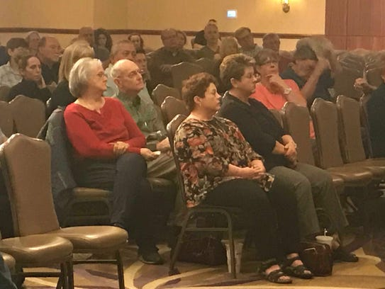 Civilians listen intently as Abilene Police Chief Stan Standridge leads a training course for civilians in active threat situations on Thursday.