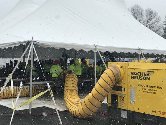 JCP&L utility workers gather in a heated tent at the