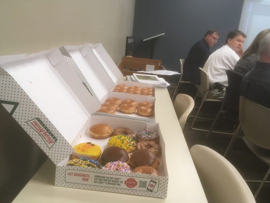 Developers offered three dozen doughnuts to the Murfreesboro Planning Commission prior to unanimous approval for the initial plan review. Chairman Bob Lamb quipped that Eddie Smotherman, right in glasses, was the only official to partake of a doughnut.