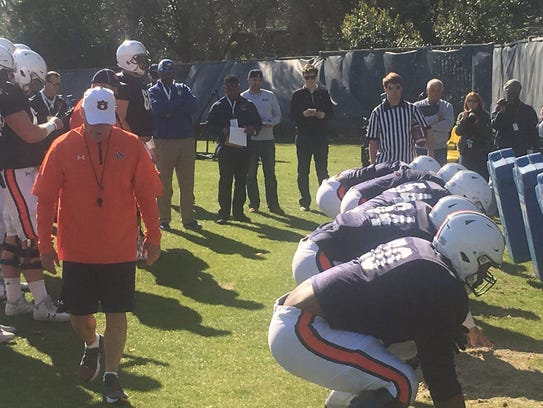 Auburn offensive line coach J.B. Grimes working with