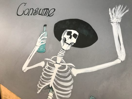 Hand painted art covers the walls inside of Tequila