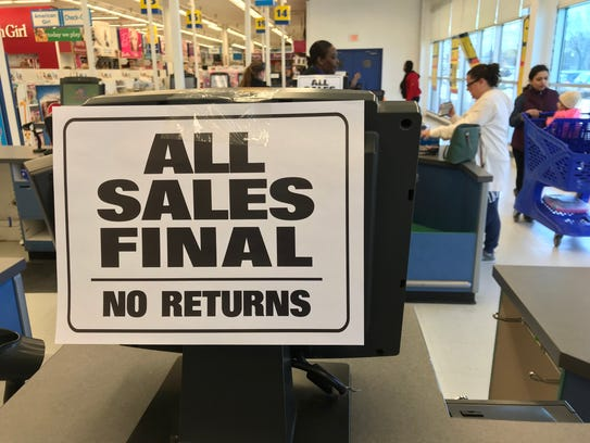 Signs reminding shoppers that all sales are final were