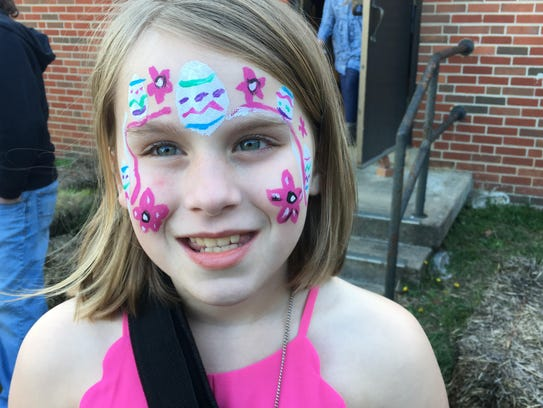 Student Maddy shows off her spring-inspired face paint.