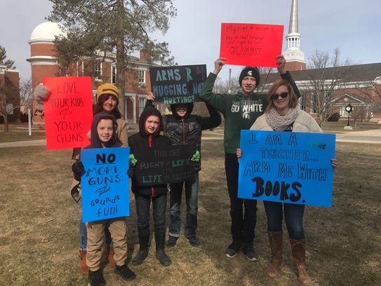 These two moms and their boys brought signs to Saturday's
