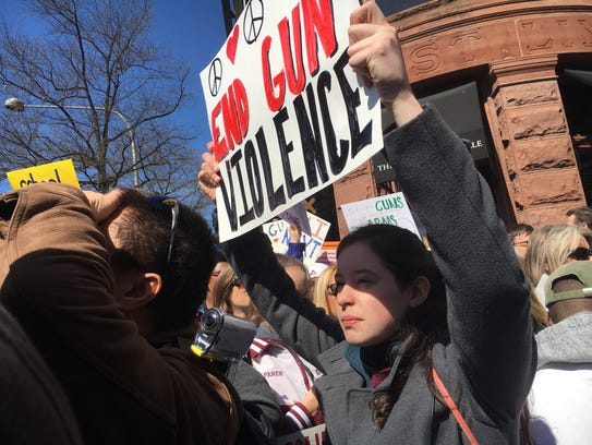"Kelsey Wagner, a junior at Concord High School, joins a rally against gun violence in the March for Our Lives in Washington on Saturday, March 24. ""There's a lot of people, but it's good,"" she said. ""I just hope we can send a message to legislators to make a change and end gun violence."""