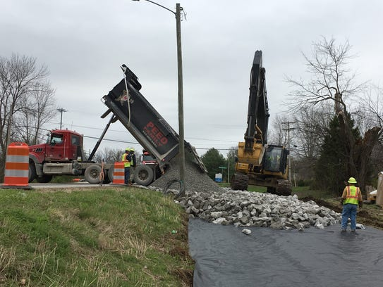 Construction crews get started building an access road