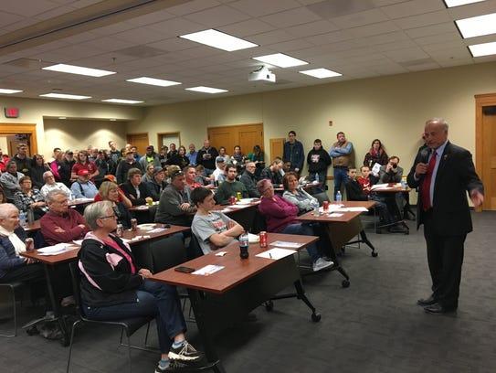U.S. Rep. Steve King addresses a crowd evenly split