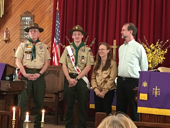 Boy Scout Troop 29 Scoutmaster Tim Woods, left, officiated