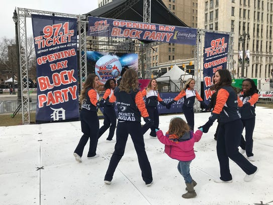 DTE workers dance with a 4-year-old girl on her first Opening Day.
