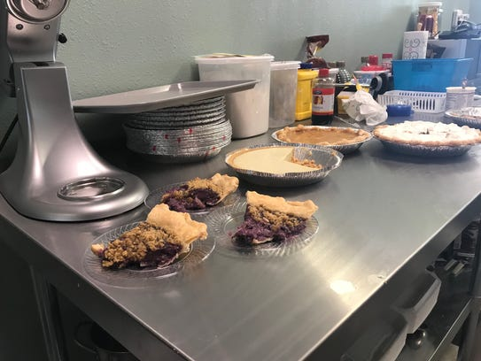 """Pie available for customers on opening day, Friday, of Life of Pie included """"The Ghost of Blueberry Hill,"""" sliced, with its combination of blueberry custard and ghost peppers. Other pies include """"The Pirate,"""" featuring key lime and jalapeno, and """"The Milford,"""" a chocolate pie."""