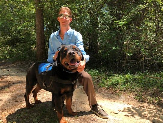 Orion Rabon with his dog Goliath. Rabon's dog Cali