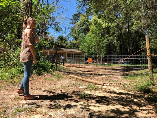 Devan-Erin Isbell talks Sunday about how the Saturday killing of a family dog took place on the Idlewild Drive property.