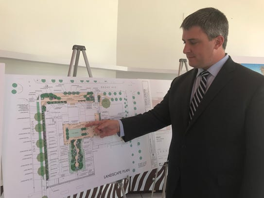 Tim McCarthy, architect for Hart Howerton, presents the latest plans for Old Naples Hotel in a pop-up shop at Third Street Plaza.