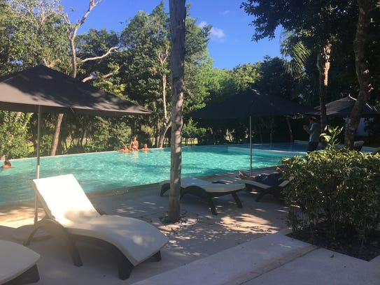 Guests and residents relax in one of the pools at the