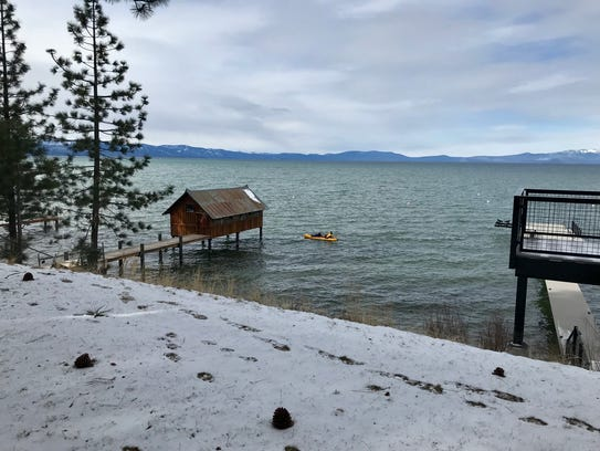 A pedal boat travels along the shores of Lake Tahoe