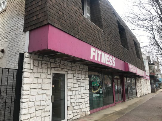 An abandoned fitness center on Broad Street in Woodbury has been demolished but equipment remains at the site.