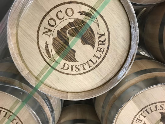 Five-gallon wood barrels used to age spirits at NOCO