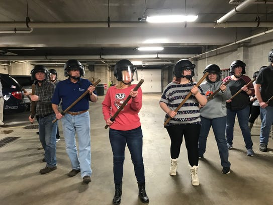 """Citizens Academy students form a """"wedge,"""" one of many crowd control formations they learned during the fifth week of classes."""
