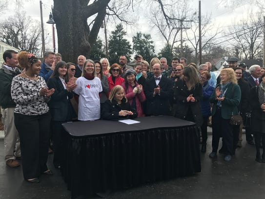 Nashville Mayor Megan Barry signs an executive order that boosts protections for trees on Feb. 13.