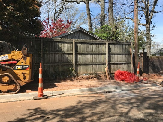 City of Greenville crews work on installing sidewalks