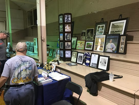 Visitors at Shoeless Joe Jackson Day look over displays