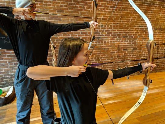 Erysse and Aren Elliott practice archery at Flight