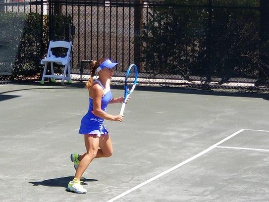 Irina Maria Bara returns a ball to her opponent during