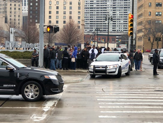 MGM Grand Detroit employees evacuated on the sidewalk