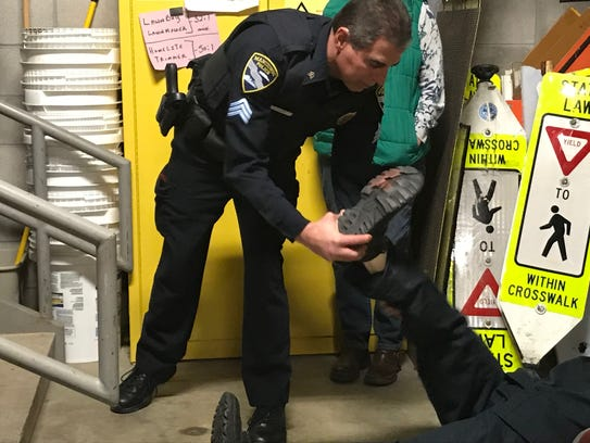 Manitowoc Police Sgt. Bruce Jacobs shows how blood