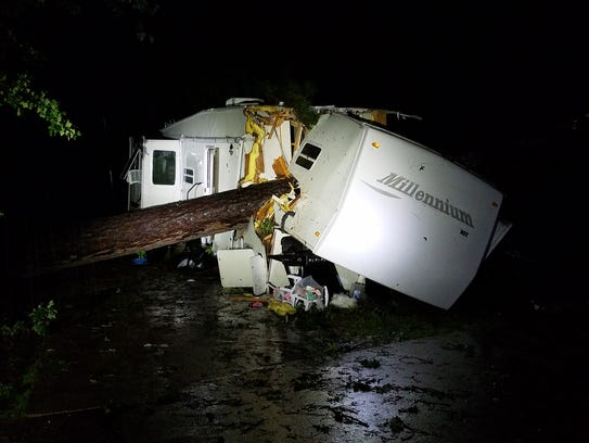Tree that fell on an RV in a Haughton, Louisiana, mobile