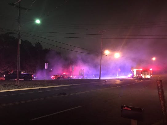 A small brush fire has erupted along Route 37 in Lakehurst,