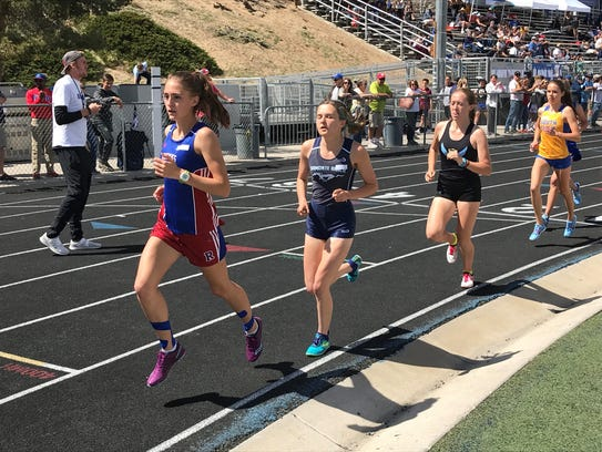Girls compete in the 3,000-meter race Saturday at the