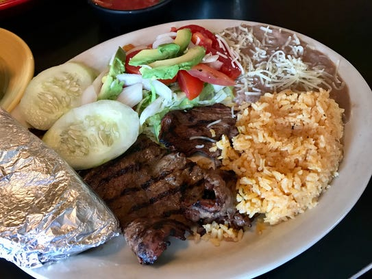 Carne asada with rice and refried beans from La Casita