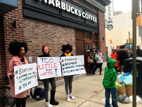 Protesters gather outside a Starbucks in Philadelphia,