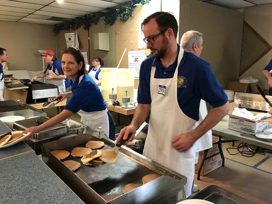 Jason Kolodziejczyk flips a stack of pancakes during