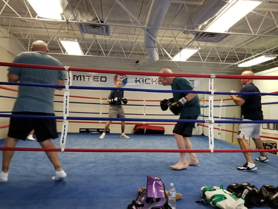 Coach David DiQuollo moves a round the ring with members