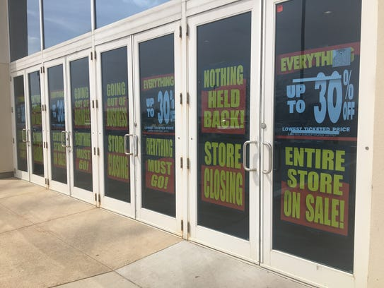 Banners advertising Younkers' liquidation sale greet
