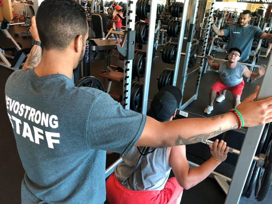 Evolutions gym member, Ray Hernandez, works out while